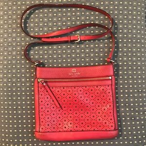 Kate Spade red laser cut cross body leather bag
